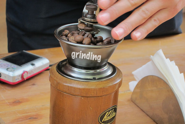 Manually grinding coffee
